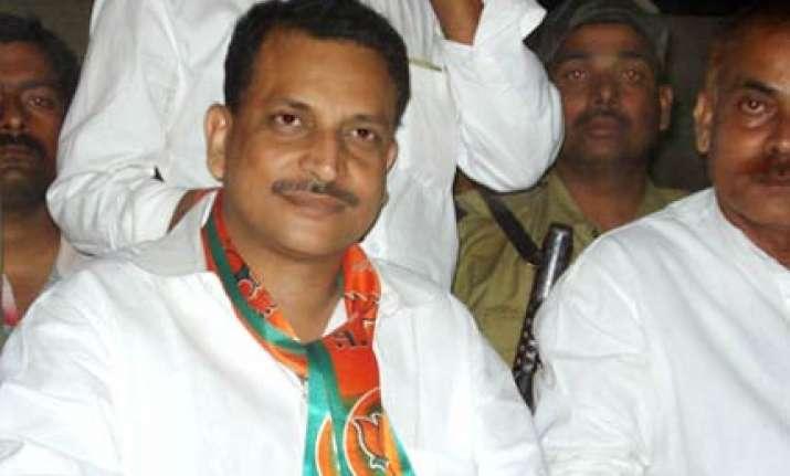 bjp slams rahul for silence on scams involving upa