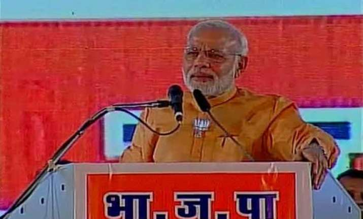modi accuses congress ncp combine of destroying maharashtra