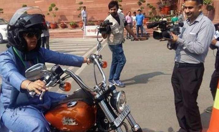 on women s day congress mp ranjeet ranjan rides harley