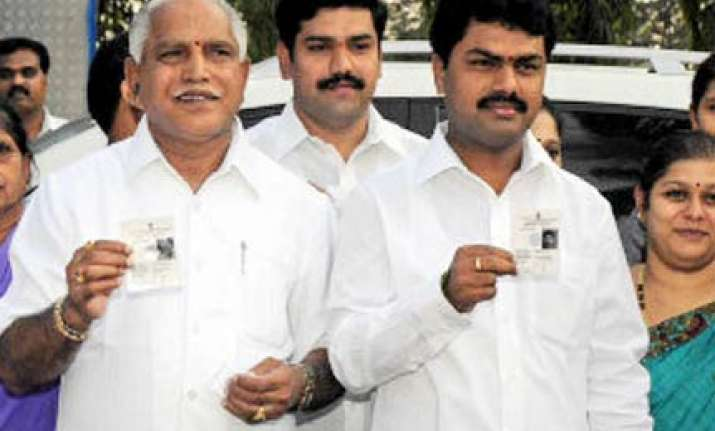 yeddyurappa acts asks his children to leave official
