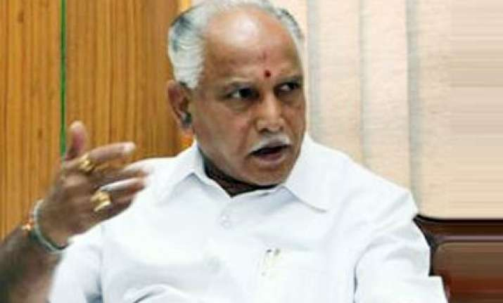 karna cm defends land allotment to family members