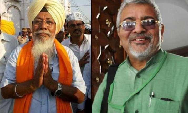 aap suspends mps dharamavira gandhi and harinder khalsa