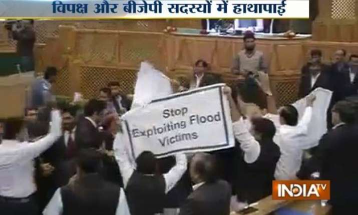 ruckus in jammu and kashmir assembly over relief to flood