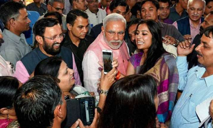 in pics narendra modi meets journalists