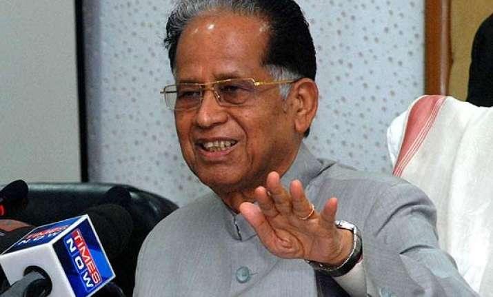 tarun gogoi opposes move to scrap plan panel