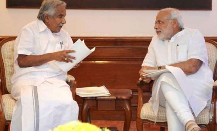 cm oommen chandy slams raid at kerala house writes to pm