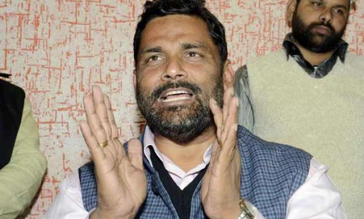 pappu yadav sends notice to sushil modi for sullying his