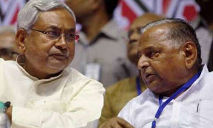 amid confusion over merger nitish asks mulayam to call meet