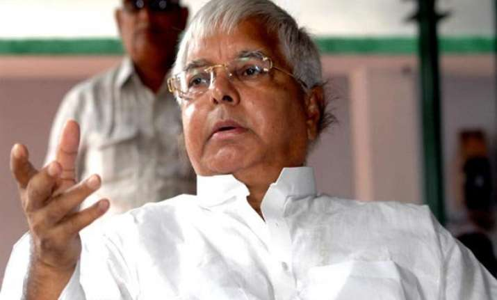 lalu accuses bjp of posing danger to manmohan singh s life