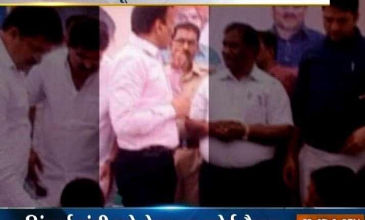 maharashtra bjp minister addresses kids with revolver
