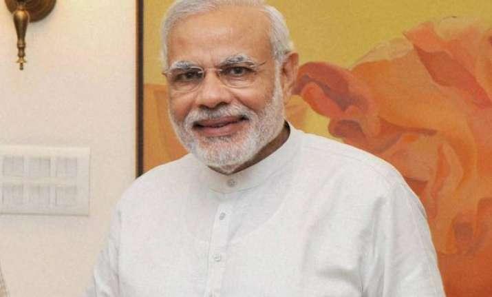 pm modi may announce a universal health cover scheme on i