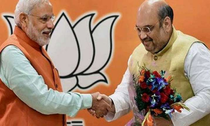 pm modi amit shah host dinner for bjp mps from up