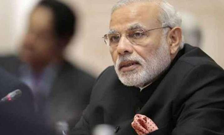 pm modi reviews progress on solar parks aadhaar