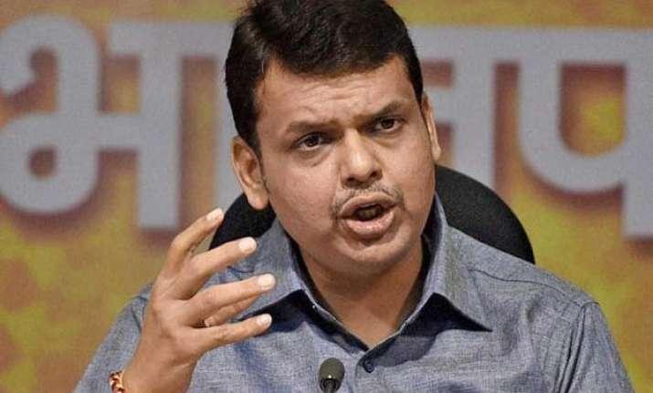 fadnavis calls rail budget practical opposition slams prabhu