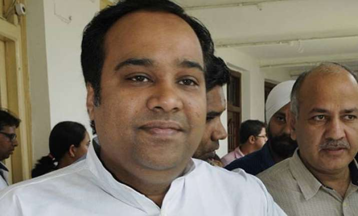 kejriwal sacks minister asim ahmed over corruption charges