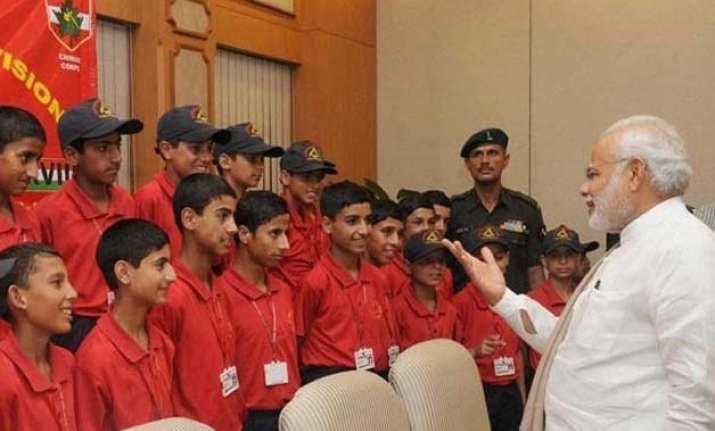 pm modi meets children from jammu and kashmir in delhi