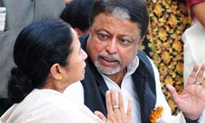 mamata banerjee accuses bjp of harassing her confidante