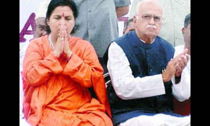 advani mum on uma s re entry to bjp