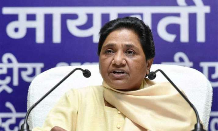 bjp plans to impose old class system alleges mayawati