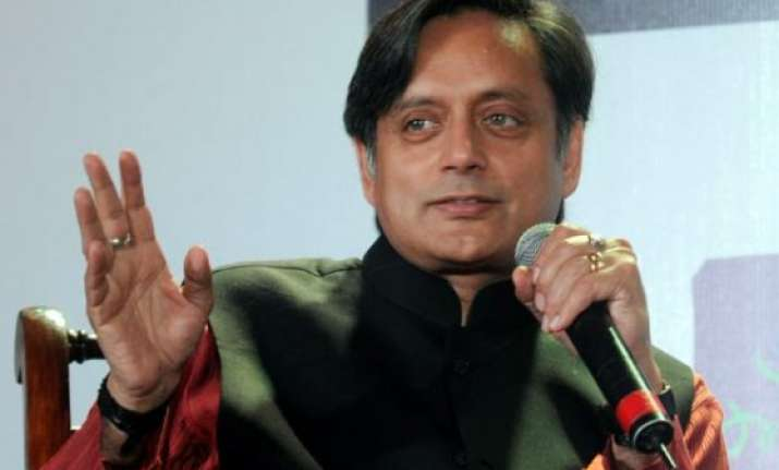tharoor takes a jibe at modi says it is time for pm s ghar