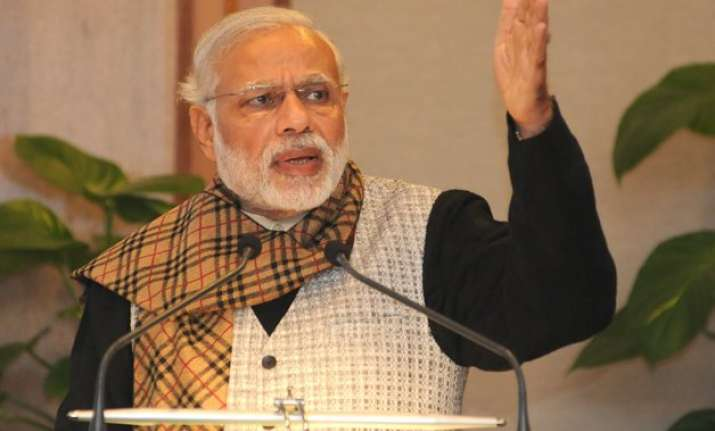 break silos get cracking to deliver results pm modi to babus