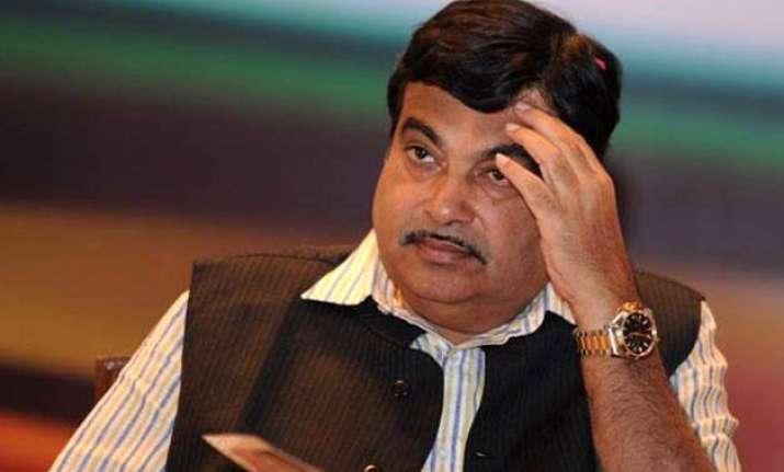 demand for gadkari resignation rocks rajya sabha again