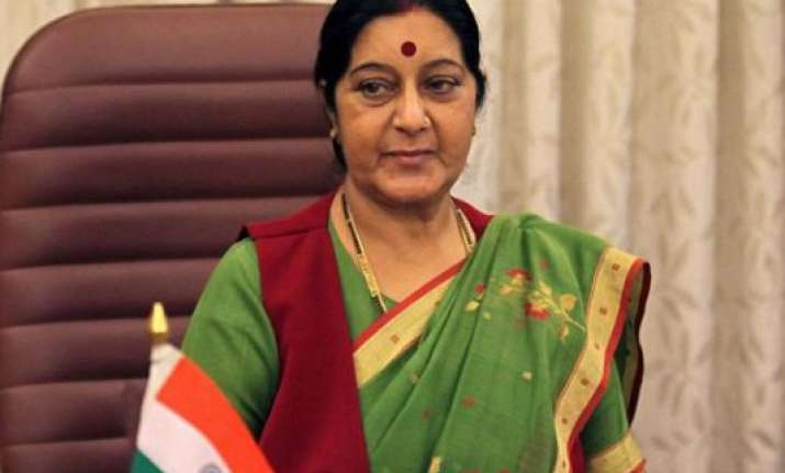 sushma swaraj exhorts bjp workers to ensure victory in