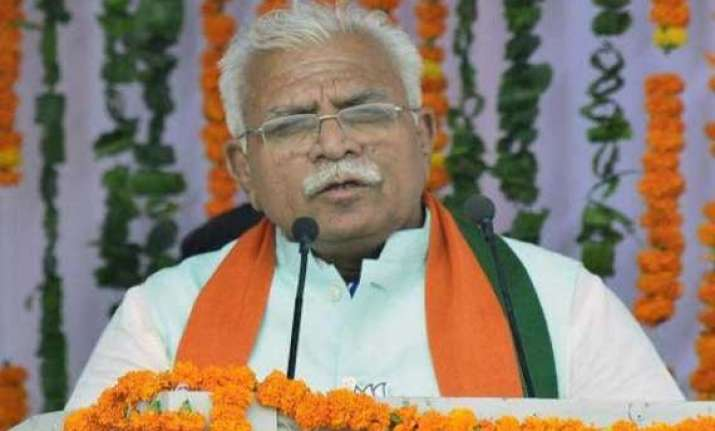 pm congratulates khattar on taking oath as haryana cm