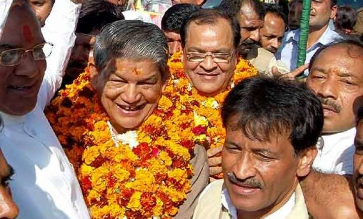oppositionbjp slams u khand cm for frequent visits to delhi