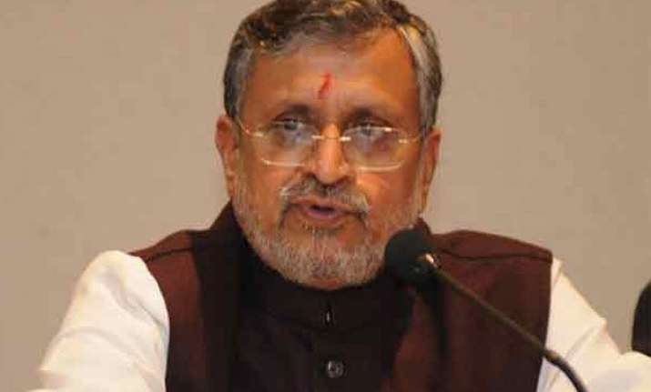 election commission cautions sushil modi for offering