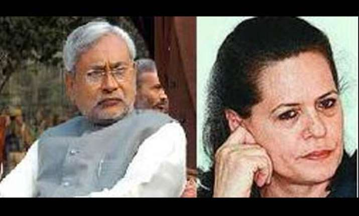 sonia congratulates nitish lashes out at oppn