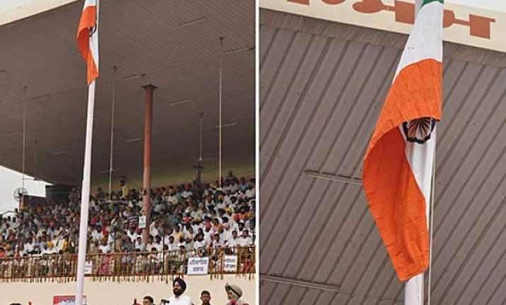 punjab minister unfurls upside down flag 2 cops suspended