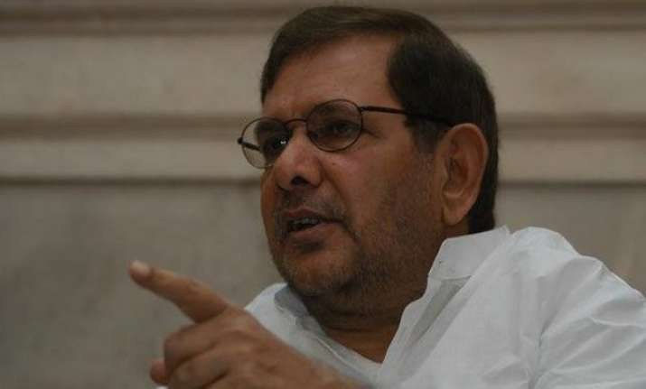 sharad yadav says merger is a done deal
