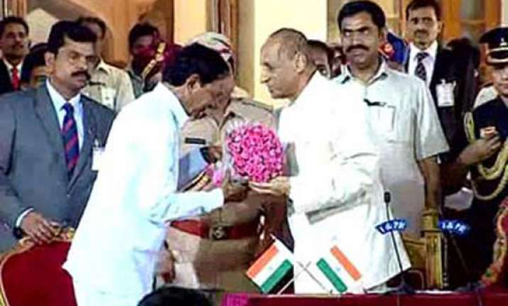 k. chandrasekhara rao takes oath as first chief minister of