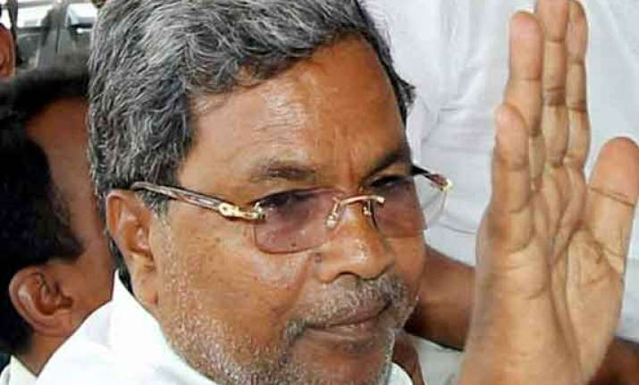 karnataka cm siddaramaiah hopeful of congress getting 18 20