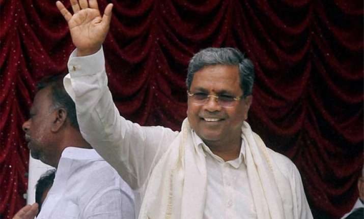 karnataka cm promises cheaper rice for lower middle class