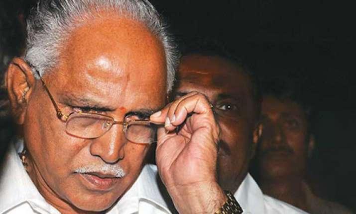 karnataka government totters as ministers back yeddyurappa