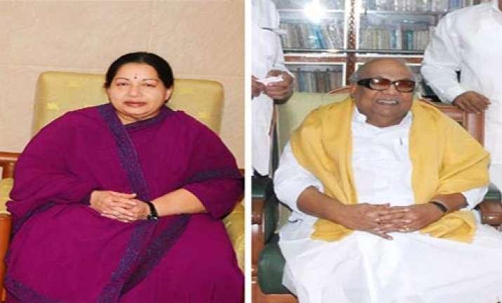 karunanidhi jayalalithaa keep fingers crossed