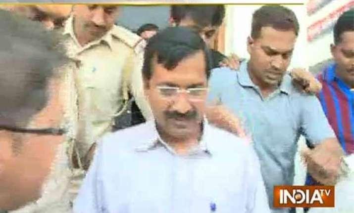 kejriwal blasts modi after police detain him