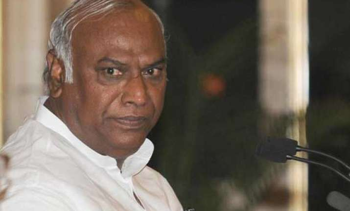 kharge questions sudden hike in rail fares