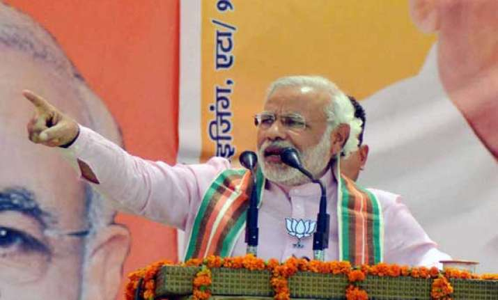 live gandhi family is arrogant and power drunk says modi in