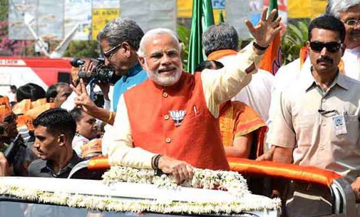 live cheered by thousands modi files nomination