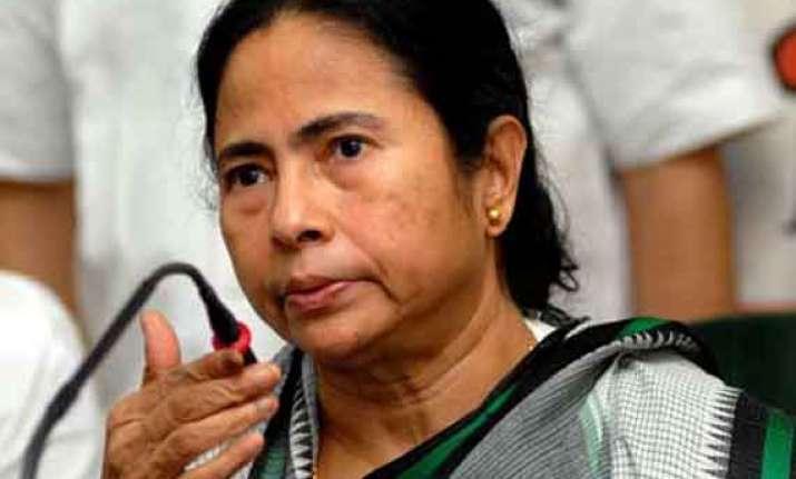 mamata accuses modi of instigating riots in assam