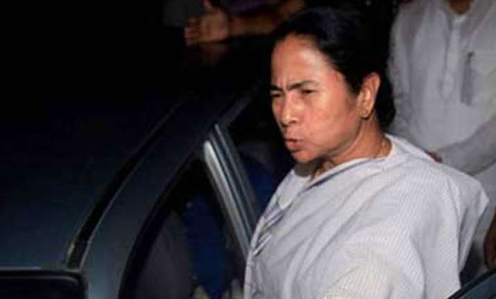 mamata ties rakhis on wrists of policemen journalists