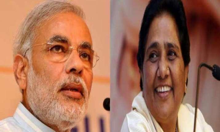mayawati attacks bjp for projecting modi as obc leader