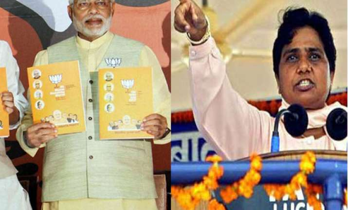 mayawati demands action against bjp for manifesto