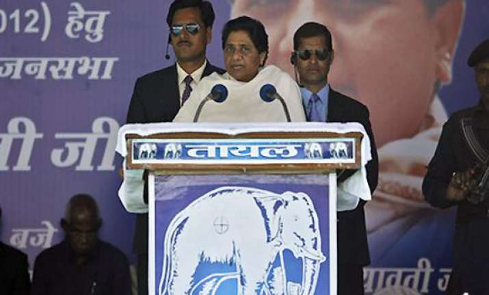 mayawati lashes out at congress says it is misleading people