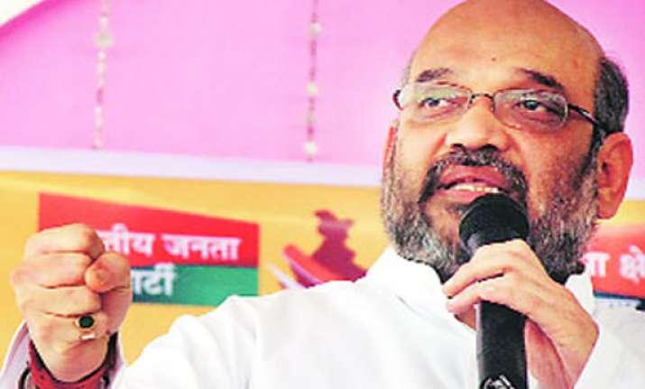modi aide s remark sparks row congress aap seek arrest