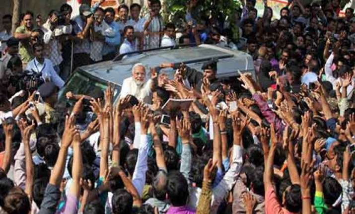 modi caught in row as millions vote in india
