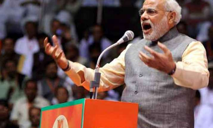 modi fires on all cylinders against mamata